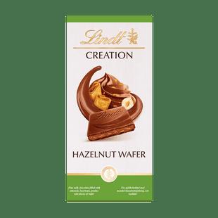 Lindt Creation Mléčná čokoláda plněná kousky lískových oříšků a oplatky 150g